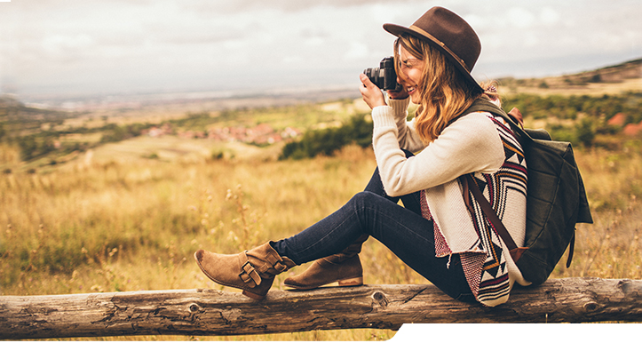 Photo of young woman photographing the nature